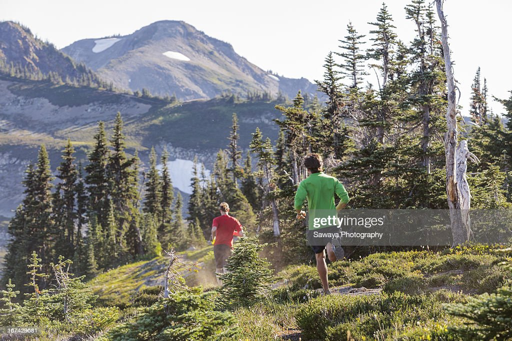 Mountain trail running in the North Cascades. : Stock Photo
