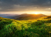 Mountain valley during bright sunset. Beautiful natural landscape in the summer time