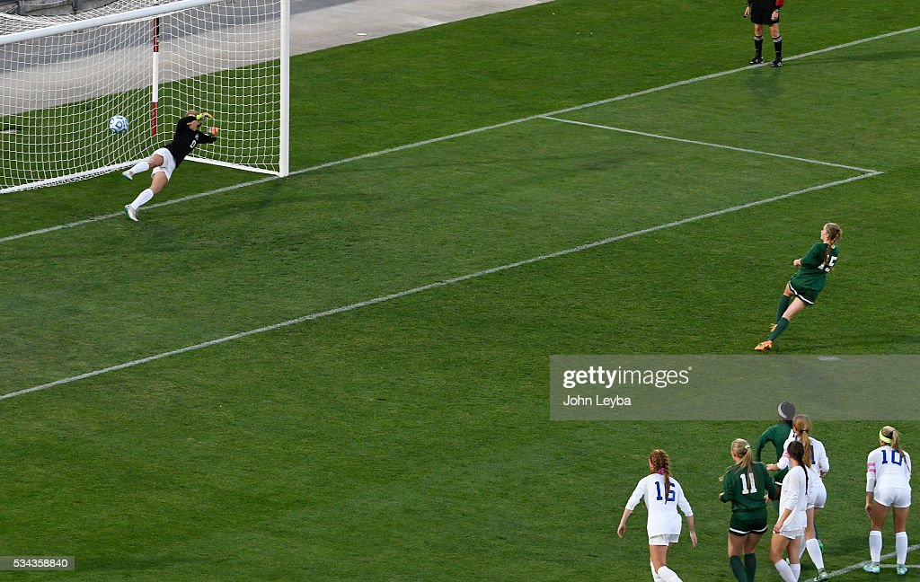 Mountain Vista Golden Eagles mf Haley Schueppert (C) (15) scores on a penalty kick as Grandview Wolves gk Jennica Johnson (1) can't make the save in the first half during the 5A state soccer championship May 25, 2016 at Dicks Sporting Goods Park.