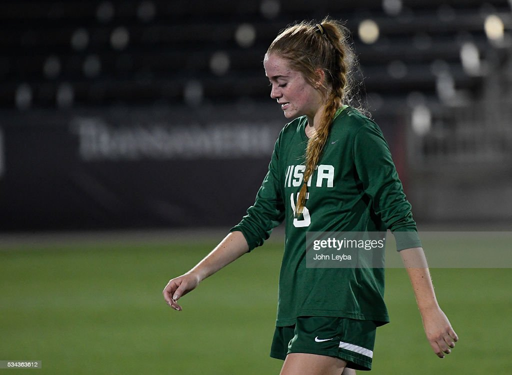 Mountain Vista Golden Eagles mf Haley Schueppert (C) (15) walks off dejected after losing to the Grandview Wolves 2-1 for the 5A state soccer championship May 25, 2016 at Dicks Sporting Goods Park.