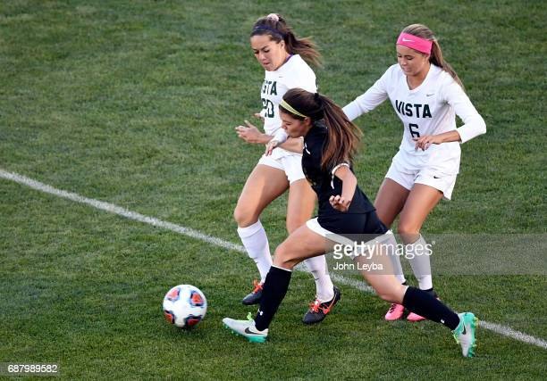 Mountain Vista Mia Bonifazi and Arapahoe Audrey Weiss battle for position on the ball in the first half during the 2017 CHSAA Girls Soccer State...
