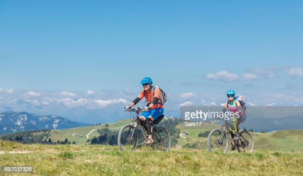 Mountainbiking couple in the Dolomites area, Italy