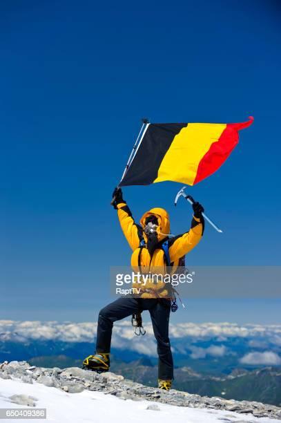 Mountaineer flying the Belgium National flag.