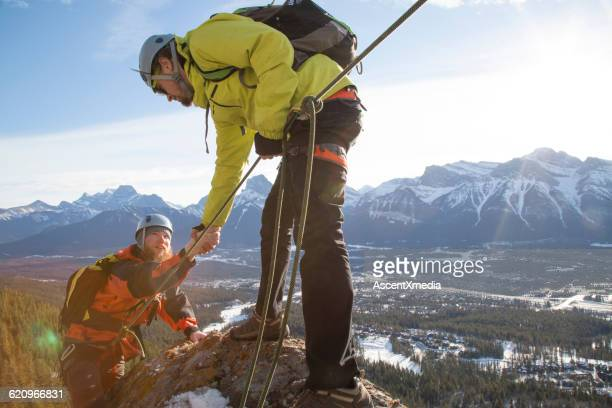Mountaineer offers a helping hand to teammate