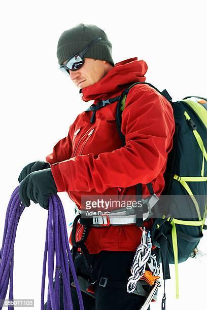 Mountaineer preparing climbing ropes