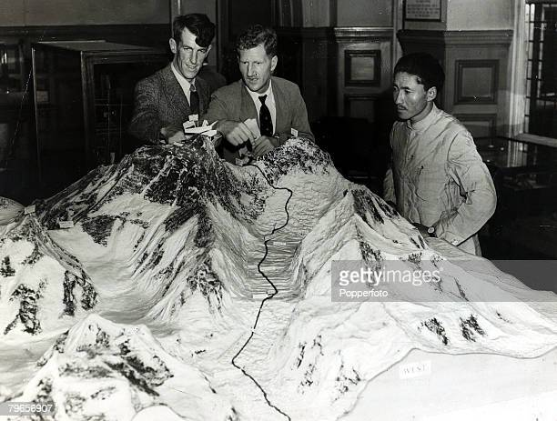 3rd July 1953 This picture shows Edmund Hillary left Colonel John Hunt and Sherpa Tenzing Norgay right at a London press conference using a large...