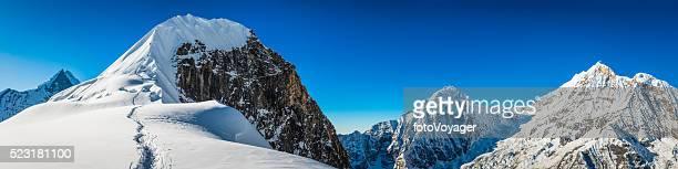Mountaineers climbing snowy mountain peak Tharpu Chuli Annapurna Himalayas Nepal