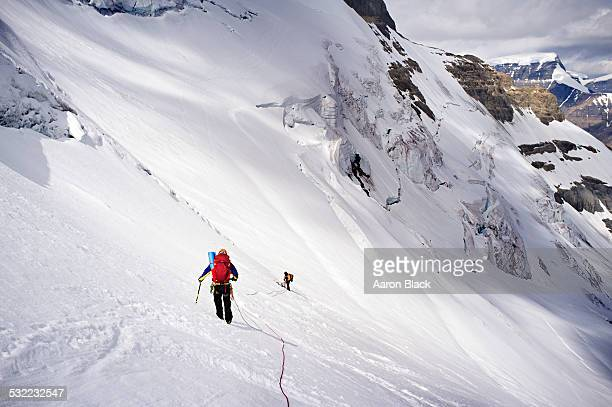 Mountaineers in sun on large glacier