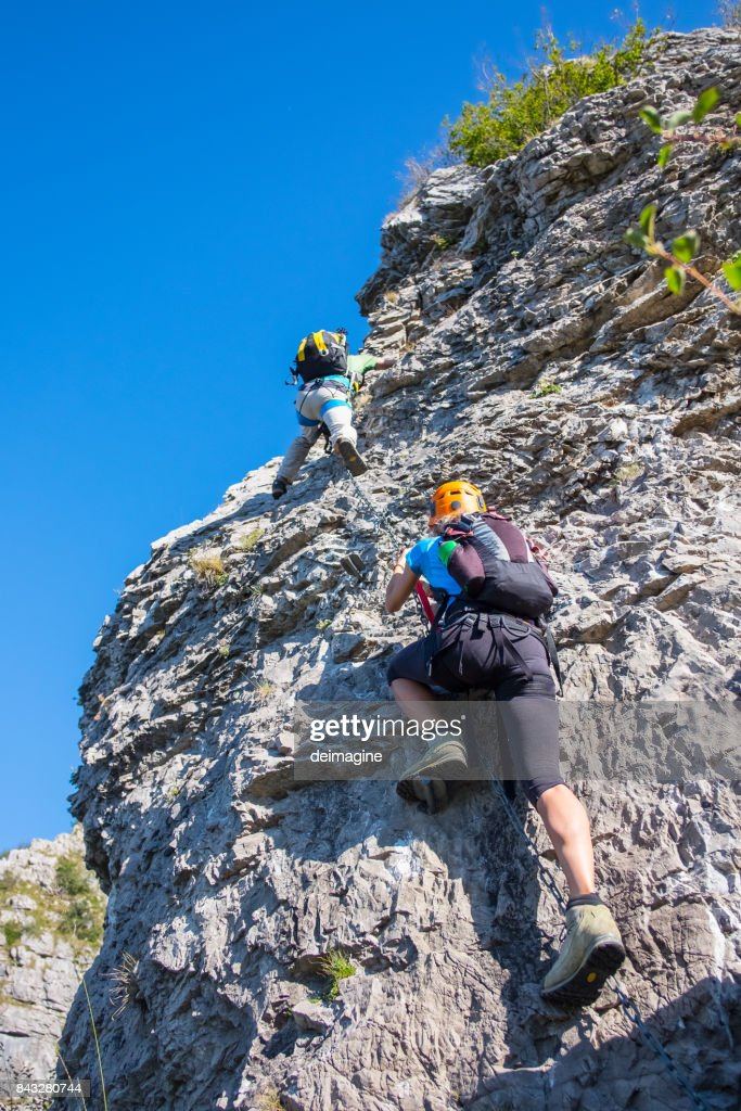 Mountaineers on equipped rockface : Stock Photo