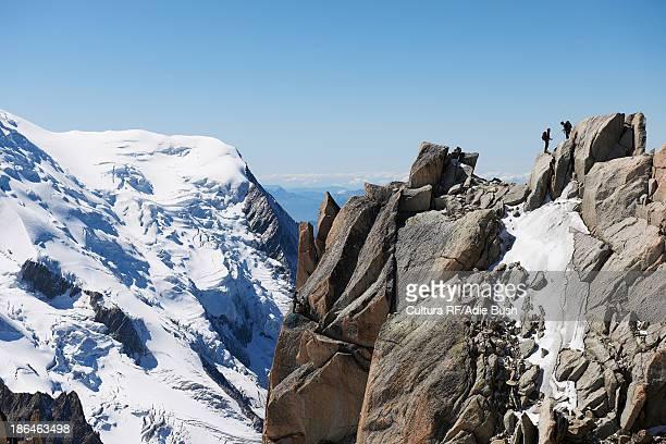 Mountaineers on summit, Chamonix, Haute Savoie, France