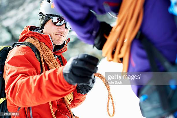 Mountaineers preparing climbing equipment