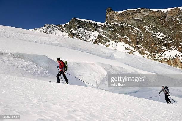 Mountaineers ski touring on snow-covered mountain, Saas Fee, Switzerland