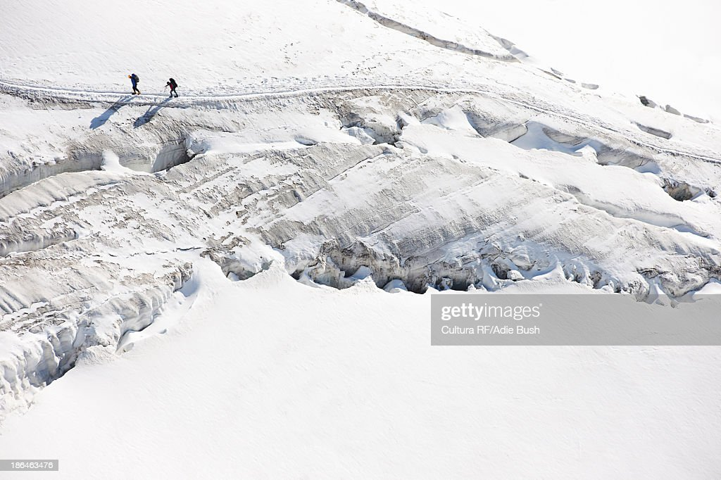 Mountaineers traversing deep snow, high angle : Stock Photo