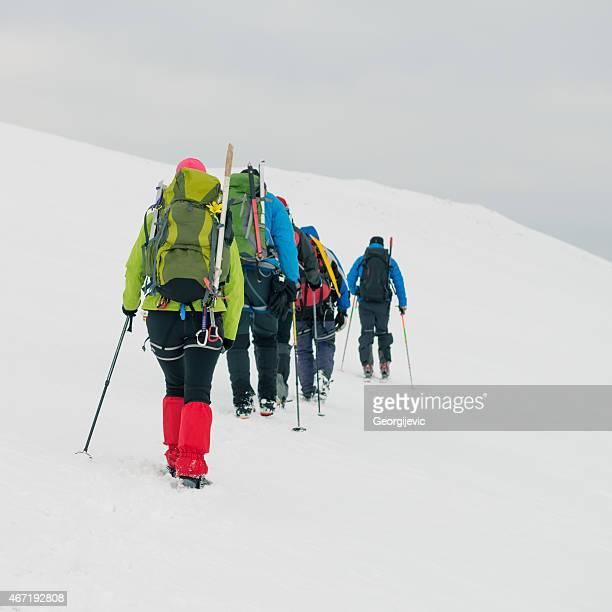 Mountaineers walking on mountain.