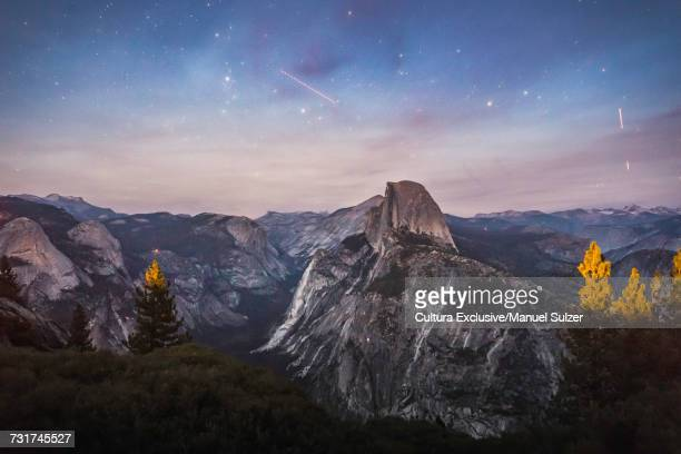 Mountains and celestial stars at dusk from Glacier Point, Yosemite National Park, USA