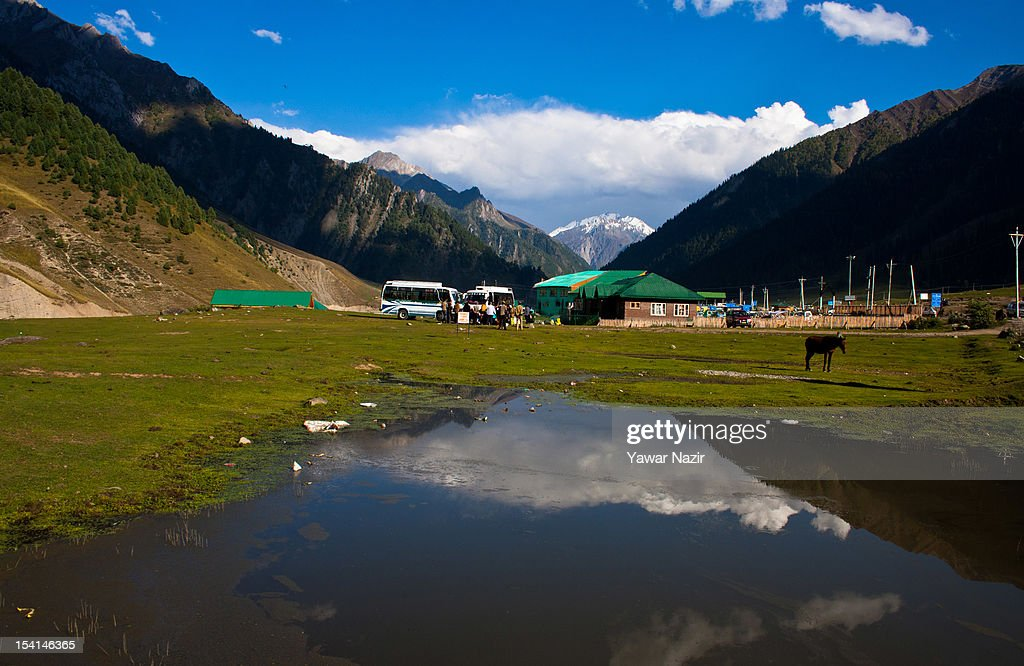 Mountains are reflected on a puddle on October 15, 2012 in Sonamarg ,89km (55 miles) east of Srinagar, the summer capital of Indian administered Kashmir, India. Sonamarg, or 'Golden Meadow' is a popular tourist resort northeast of Srinagar, the summer capital of Indian administered Kashmir. Besides pine forests, gushing streams and snow-covered mountains, Thajiwas Glacier is a major attraction for tourists. Kashmir has been a contested land between nuclear neighbors India and Pakistan since 1947, the year both the countries attained freedom from the British rule.