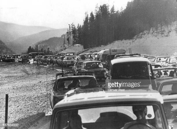 Mountains Crowded And Cold Cars wait on the west side of the Eisenhower Memorial Tunnel above after Interstate 70 was closed Sunday because of high...