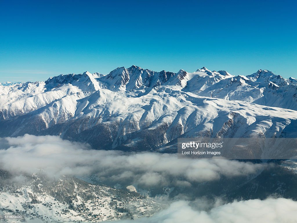 Mountains in snow with cloud