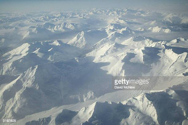 Mountains near Prince William Sound are buried in snow on March 31 2004 north of Valdez Alaska Fifteen years after the Exxon Valdez supertanker split...