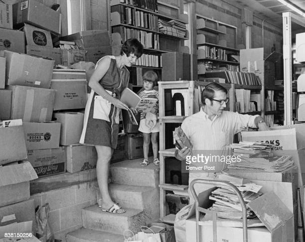 Mountains Of Books Gathered For Sale Mr and Mrs Dan Brickley Littleton look over volumes left at Bemis Public Library 6014 S Datura St for the...