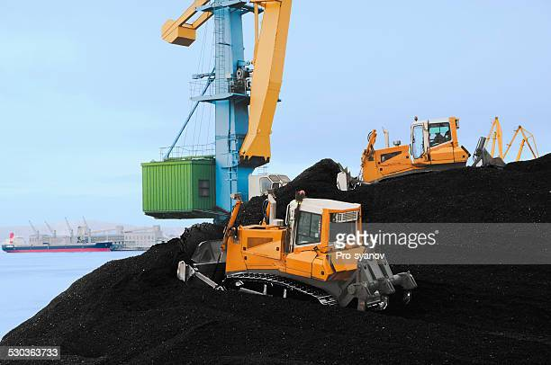 Mountains of coal in the port.