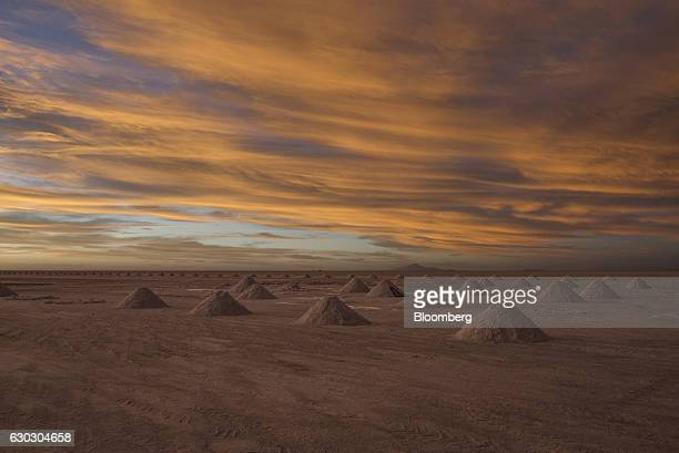 Mountains of salt stand at the Salar de Uyuni during sunset in Potosi Bolivia on Saturday Dec 10 2016 Bolivia has the largest lithium deposits of any...