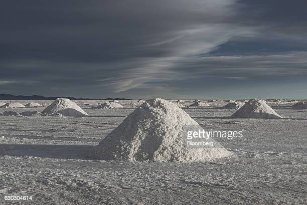 Mountains of salt stand at the Salar de Uyuni in Potosi Bolivia on Sunday Dec 11 2016 Bolivia has the largest lithium deposits of any country which...