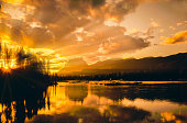Bow River sunset with reflections in the Canadian Rockies, Banff NP, Canada