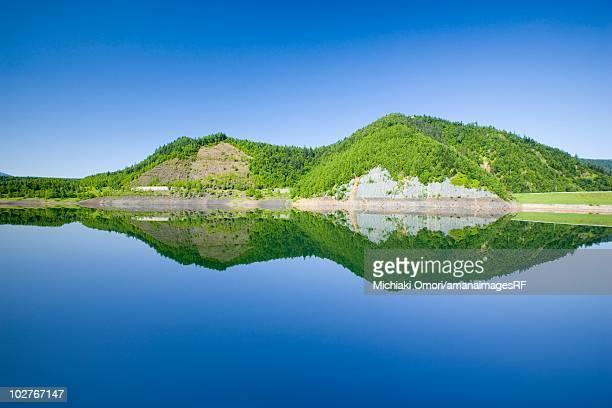 Mountains reflected in a calm lake, Kamikawa, Hokkaido, Japan