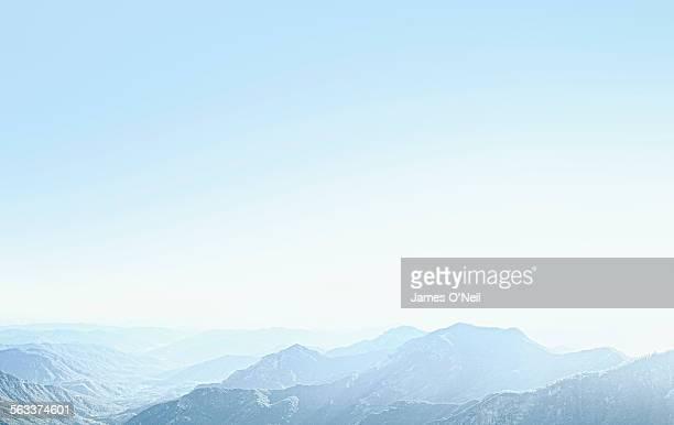 mountains with a sky blue haze