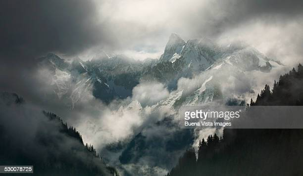Mountains with clouds and fog in winter