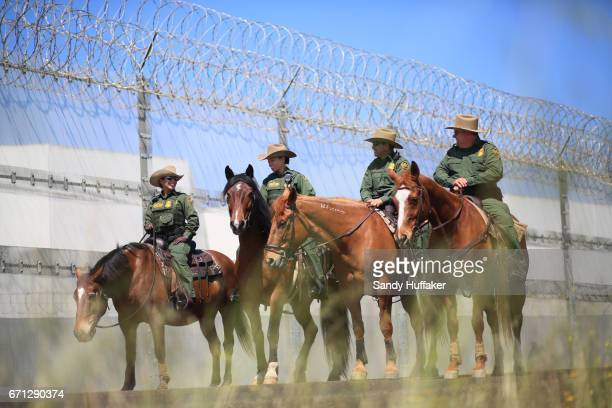 Mounted Border Patrol agents on hordeback along the USMexico border during a media tour with Department of Homeland Security John Kelly and Attorney...