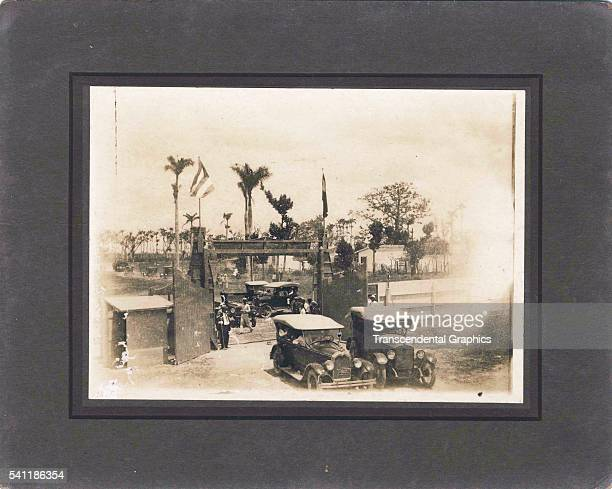Mounted cabinet photograph shows the front gates of Estadio Tropical Cerveza in winter Guines Cuba 1925