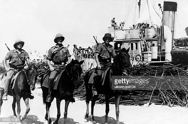 Mounted German patrol service is guarding the port of Cephalonia after it was captured by German forces