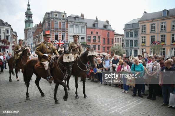 Mounted historical society members dressed in uniforms to represent World War I British India Cavalry sit attend World War I centenary commemorations...
