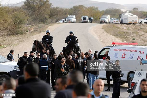 Mounted Israeli police speak with ArabIsrael protestors in the Bedouin village of Umm alHiran which is not recognized by the Israeli government near...