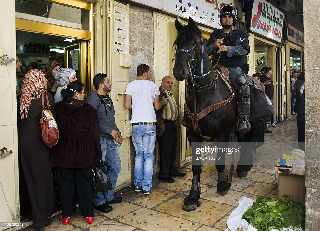 A mounted Israeli policeman monitors the streets near Damascus gate in Jerusalem on May 15, 2013 as Palestinian demonstrators gathered to mark the 65th Nakba or 'catastrophe' of the Jewish state's creation in 1948, during which 760,000 Palestinians fled their homes. Thousands of Palestinians took to the streets in the West Bank and the Gaza Strip to demonstrate on Nakba Day and assert their 'right to return' to where their ancestors fled after the Israeli victory over Arab armies.
