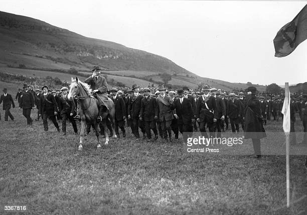 A mounted National Volunteer saluting the flag during a drill at Keash County Sligo The Irish National Volunteers objected to Irish involvement on...