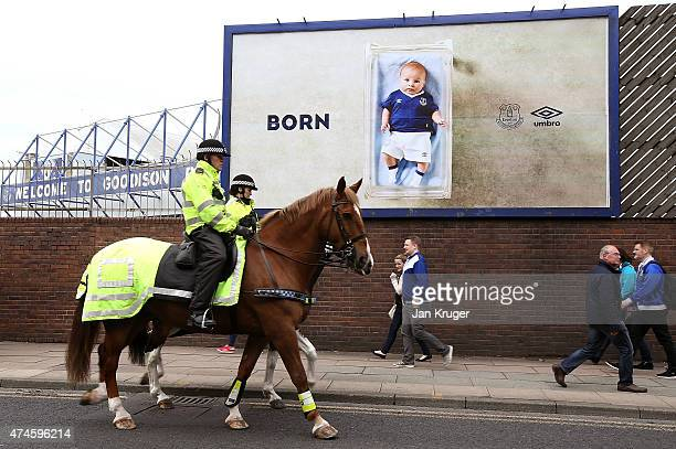 Mounted police are seen outside the stadium prior to the Barclays Premier League match between Everton and Tottenham Hotspur at Goodison Park on May...
