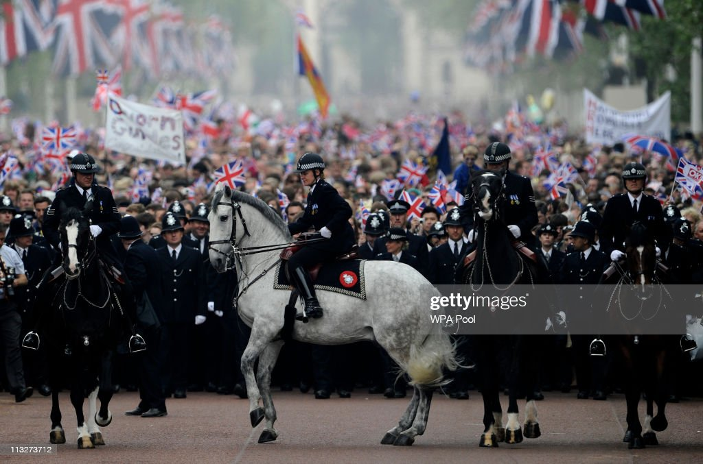 Mounted police control the crowd as they walk along the Processional Route to Buckingham Palace to celebrate the Royal Wedding of Prince William, Duke of Cambridge and Catherine, Duchess of Cambridge at Westminster Abbey on April 29, 2011 in London, England. The marriage of the second in line to the British throne is to be led by the Archbishop of Canterbury and will be attended by 1900 guests, including foreign Royal family members and heads of state. Thousands of well-wishers from around the world have also flocked to London to witness the spectacle and pageantry of the Royal Wedding.