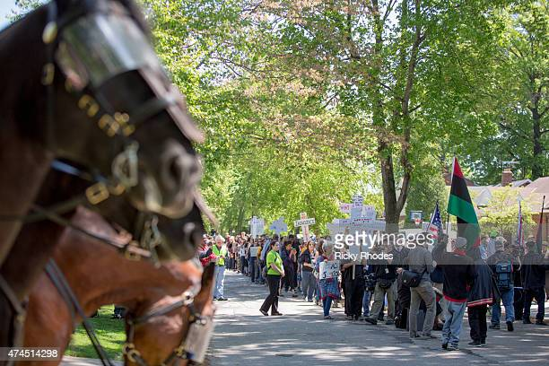 Mounted police follow a procession of people as they protest outside the house of Prosecutor Timothy McGinty in reaction to Cleveland police officer...