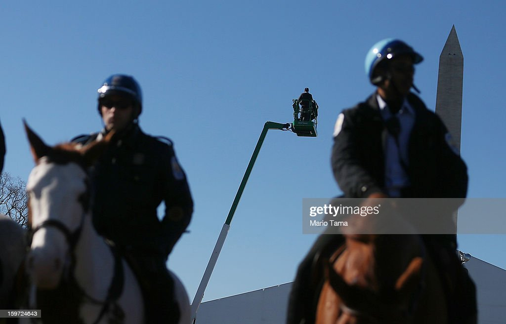 Mounted police keep watch as a cherry picker is tested in front of the Washington Monument on the National Mall as Washington prepares for President Barack Obama's second inauguration on January 19, 2013 in Washington, DC. The U.S. capital is preparing for the second inauguration of U.S. President Barack Obama, which will take place on January 21.