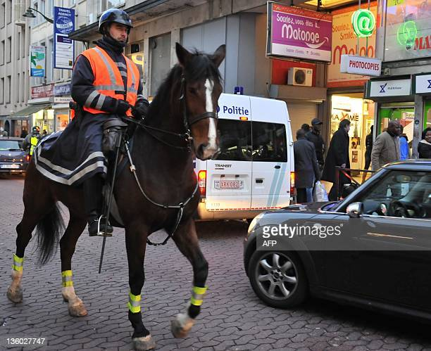 A mounted police officer patrols in a street in the local Congolese community in the Matonge district in Brussels on December 20 2011 after protests...