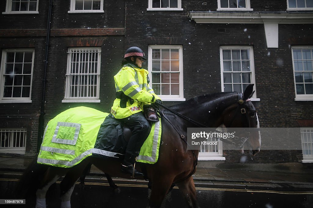 A mounted Police Officer rides through the snow on January 14, 2013 in London, England. Heavy snow is falling in parts of the United Kingdom.