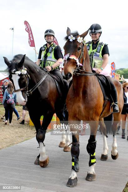 Mounted police officers on duty on day 4 of the Glastonbury Festival 2017 at Worthy Farm Pilton on June 25 2017 in Glastonbury England