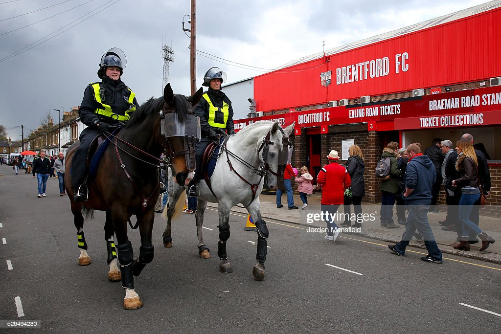 Mounted police officers patrol outside the ground ahead of the Sky Bet Championship match between Brentford and Fulham at Griffin Park on April 30, 2016 in Brentford, England.