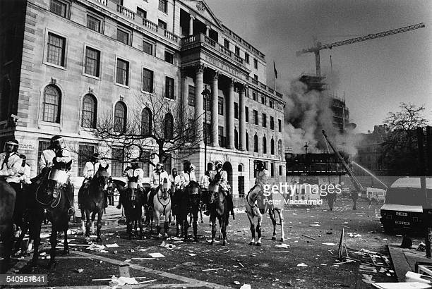 Mounted police outside the South African Embassy during the Poll Tax Riots Trafalgar Square London 31st March 1990