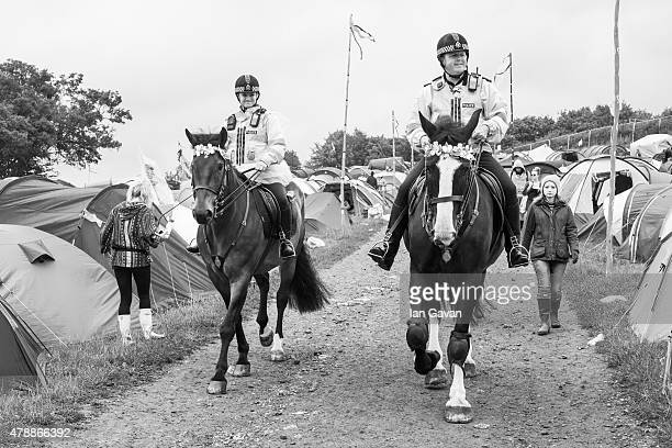 Mounted Police patrol a track at the Glastonbury Festival at Worthy Farm Pilton on June 28 2015 in Glastonbury England Now its 45th year the festival...