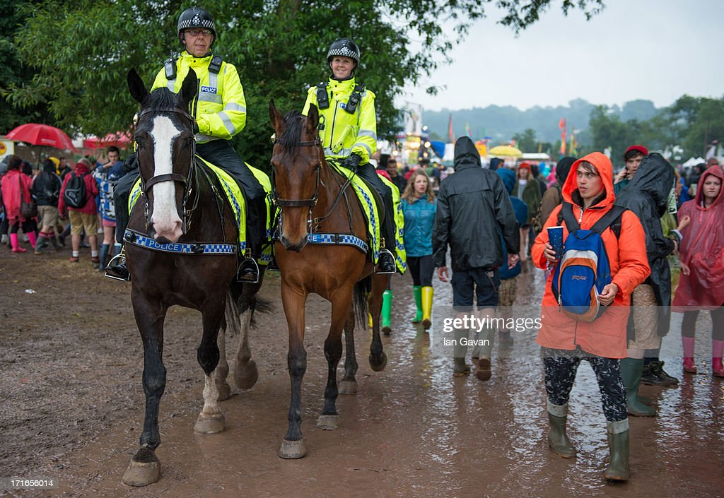 Mounted Police patrol as rain falls during day 1 of the 2013 Glastonbury Festival at Worthy Farm on June 27, 2013 in Glastonbury, England.