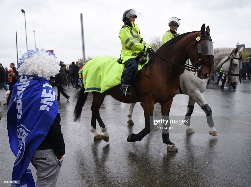 Mounted police patrol outside Old Trafford stadium before the English Premier League football match between Manchester United and Leicester City in Manchester, north west England, on May 1, 2016. / AFP / OLI SCARFF / RESTRICTED TO EDITORIAL USE. No use with unauthorized audio, video, data, fixture lists, club/league logos or 'live' services. Online in-match use limited to 75 images, no video emulation. No use in betting, games or single club/league/player publications. /